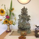 Altar at Empty Nest Zendo with statue of Tara and flowers